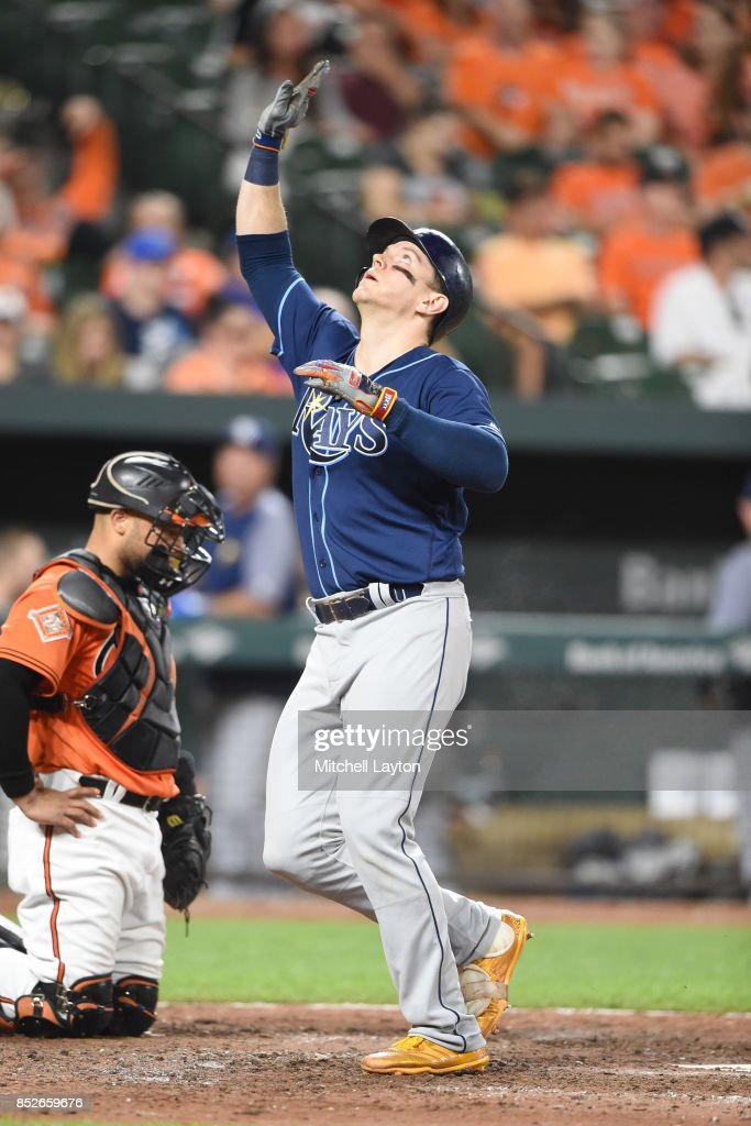 Logan Morrison #7 of the Tampa Bay Rays celebrates a solo home run in the ninth inning during a baseball game against the Baltimore Orioles at Oriole Park at Camden Yards on September 23, 2017 in Baltimore, Maryland.
