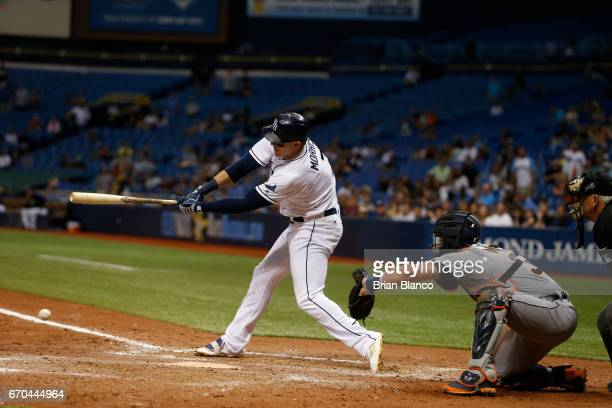 Logan Morrison of the Tampa Bay Rays hits a fielder's choice in front of James McCann of the Detroit Tigers to set up the gamewinning run scored by...