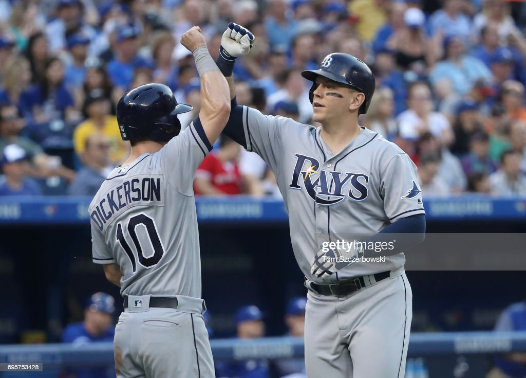 Logan Morrison #7 of the Tampa Bay Rays is congratulated by Corey Dickerson #10 after hitting a three-run home run in the third inning during MLB game action against the Toronto Blue Jays at Rogers Centre on June 13, 2017 in Toronto, Canada.