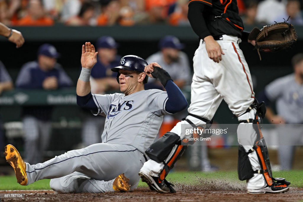 Logan Morrison #7 of the Tampa Bay Rays scores during the third inning against the Baltimore Orioles at Oriole Park at Camden Yards on September 22, 2017 in Baltimore, Maryland.