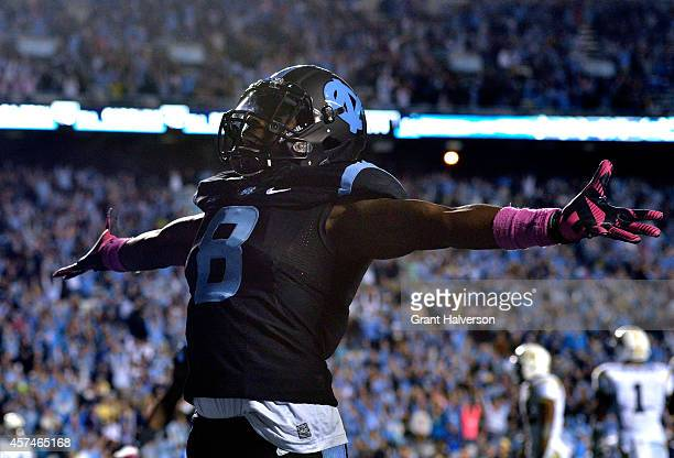 J Logan of the North Carolina Tar Heels celebrates after scoring the gamewinning touchdown against the Georgia Tech Yellow Jackets during the fourth...