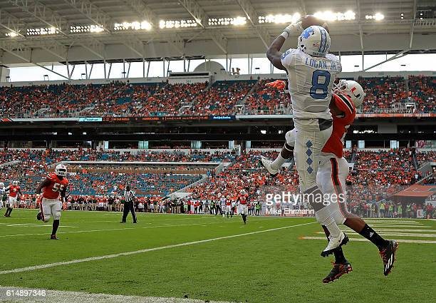 Logan of the North Carolina Tar Heels has a pass broken up by Corn Elder of the Miami Hurricanes during a game at Hard Rock Stadium on October 15,...