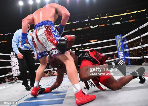 Logan Paul knocks down KSI during their pro debut fight at Staples Center on November 9 2019 in Los Angeles California KSI won by decision