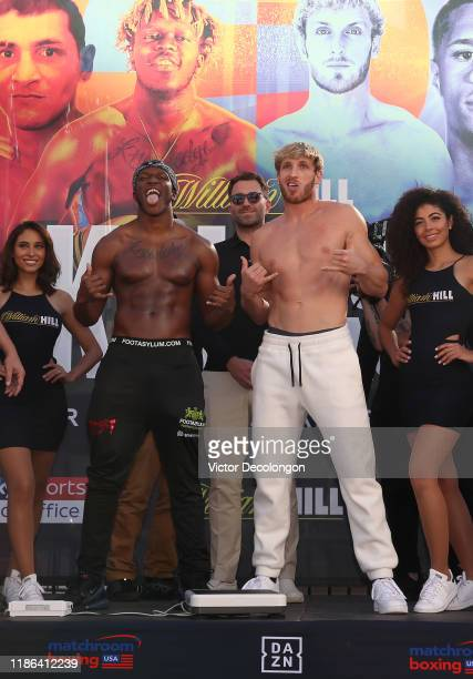 Logan Paul mocks and imitates KSI while promoter Eddie Hearn looks on after the official weighin at LA Live Xbox Plaza on November 08 2019 in Los...