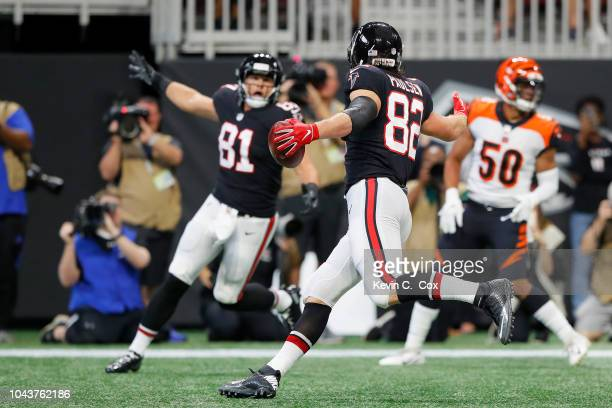Logan Paulsen of the Atlanta Falcons celebrates a touchdown during the second quarter against the Cincinnati Bengals at Mercedes-Benz Stadium on...