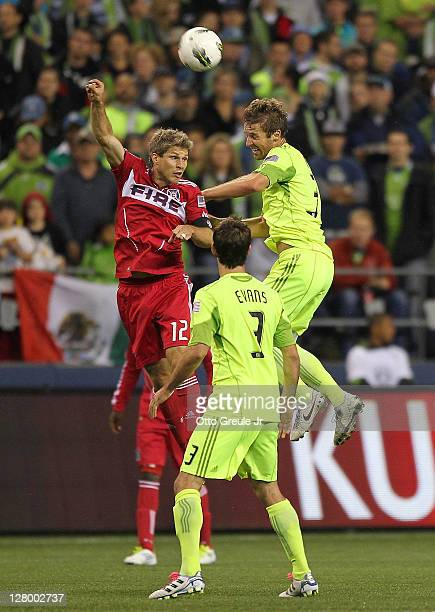 Logan Pause of the Chicago Fire heads the ball against Brad Evans of the Seattle Sounders FC during the 2011 Lamar Hunt US Open Cup Final at...