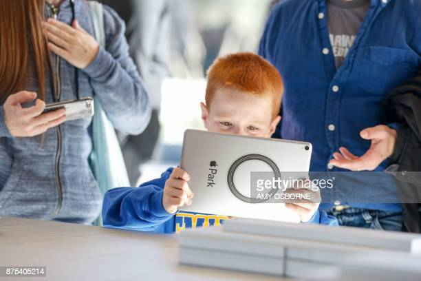 Logan Roe tries out the augmented reality system that shows what the finished Apple Park will look like at the opening of the Apple Park Visitor...