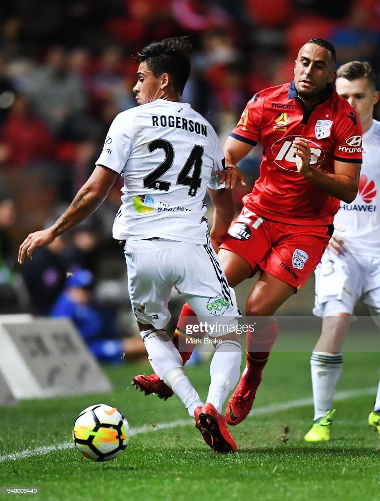 Logan Rogerson of Wellington Phoenix and Tarek Elrich of Adelaide United during the round 25 A-League match between Adelaide United and the Wellington Phoenix at Coopers Stadium on March 30, 2018 in Adelaide, Australia.