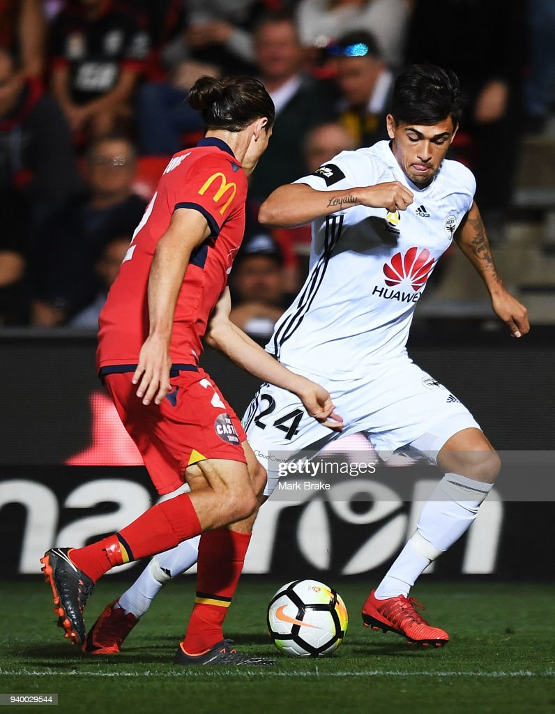 Logan Rogerson of Wellington Phoenix gets around Michael Marrone of Adelaide United during the round 25 A-League match between Adelaide United and the Wellington Phoenix at Coopers Stadium on March 30, 2018 in Adelaide, Australia.