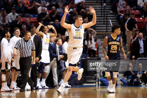 Logan Routt of the West Virginia Mountaineers reacts after a play in the second half against the Murray State Racers during the first round of the...