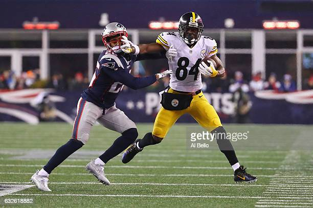 Logan Ryan of the New England Patriots attempts to tackle Antonio Brown of the Pittsburgh Steelers in the AFC Championship Game at Gillette Stadium...