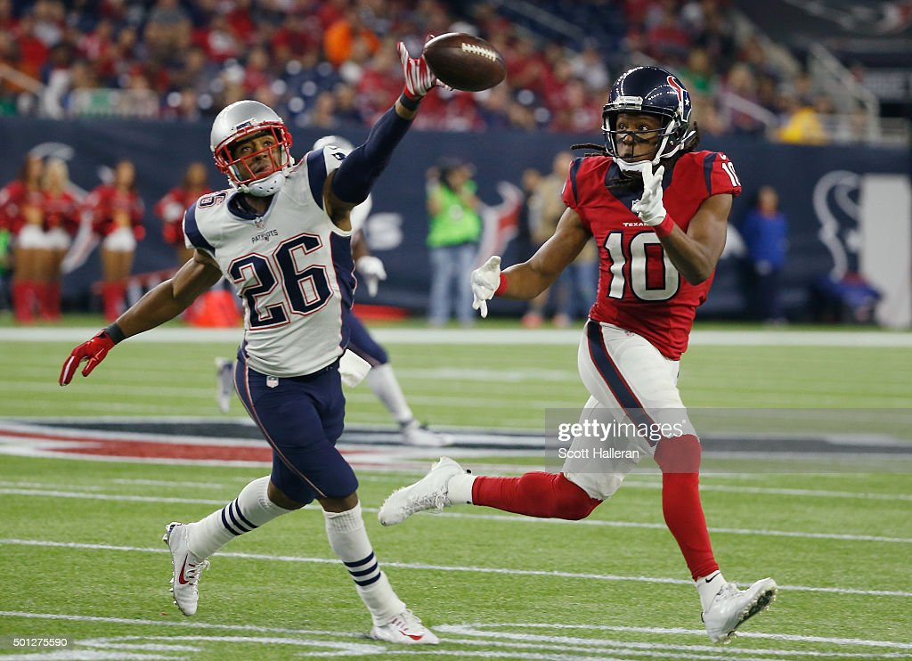 Logan Ryan #26 of the New England Patriots defends against DeAndre Hopkins #10 of the Houston Texans during their game at NRG Stadium on December 13, 2015 in Houston, Texas.