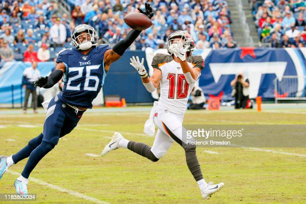Logan Ryan of the Tennessee Titans blocks a pass going to Scott Miller of the Tampa Bay Buccaneers during the first half at Nissan Stadium on October...