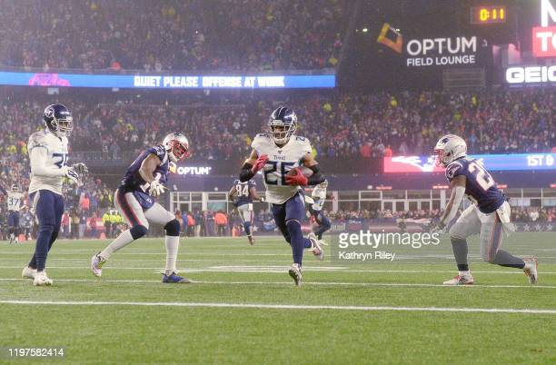 Logan Ryan of the Tennessee Titans carries the ball to score a touchdown against the New England Patriots in the fourth quarter of the AFC Wild Card...