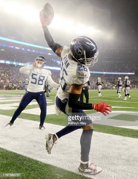Logan Ryan of the Tennessee Titans celebrates his touchdown against the New England Patriots in the AFC Wild Card Playoff game at Gillette Stadium on...
