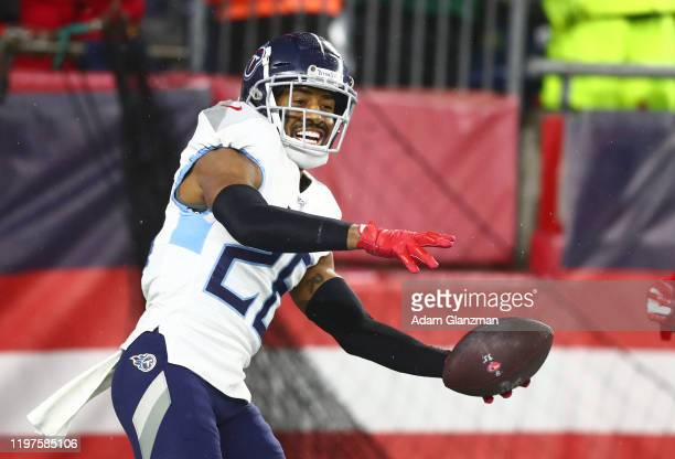 Logan Ryan of the Tennessee Titans celebrates his touchdown against the New England Patriots in the fourth quarter of the AFC Wild Card Playoff game...