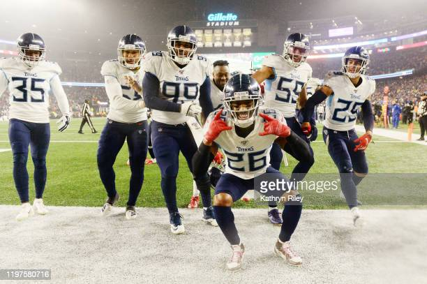 Logan Ryan of the Tennessee Titans celebrates his touchdown with teammates in the fourth quarter of the AFC Wild Card Playoff game against the New...
