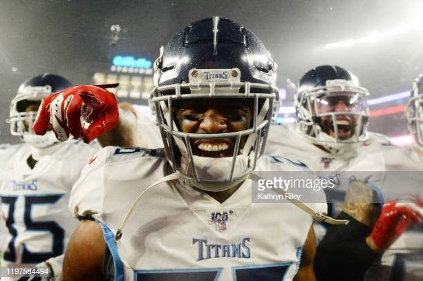 Logan Ryan of the Tennessee Titans celebrates his touchdown with teammates against the New England Patriots in the fourth quarter of the AFC Wild...