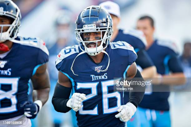 Logan Ryan of the Tennessee Titans jogs onto the field before a game against the New England Patriots during week two of the preseason at Nissan...