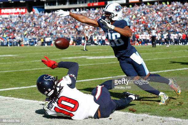 Logan Ryan of the Tennessee Titans swats away a pass intended for DeAndre Hopkins of the Houston Texans during the first half at Nissan Stadium on...