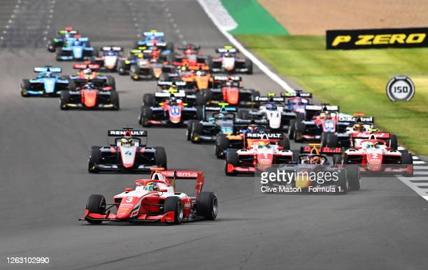 Logan Sargeant of United States and Prema Racing leads Liam Lawson of New Zealand and Hitech Grand Prix into turn one at the start during race one of...