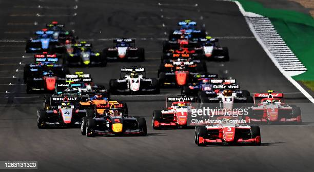 Logan Sargeant of United States and Prema Racing leads Liam Lawson of New Zealand and Hitech Grand Prix and the rest of the field towards turn one at...