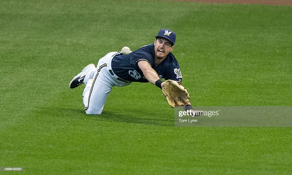 Logan Schafer #1 of the Milwaukee Brewers makes a diving catch on a fly ball hit to left by Paul Goldschmidt #44 of the Arizonia Diamondbacks at Miller Park on May 7, 2014 in Milwaukee, Wisconsin.