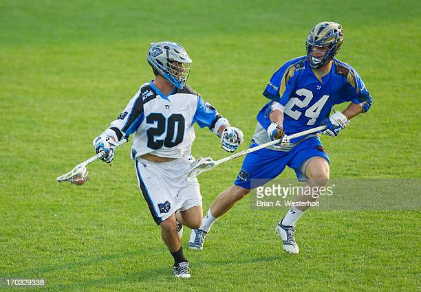 Logan Schuss of the Ohio Machine is defended by Ryan Flanagan of the Charlotte Hounds at American Legion Memorial Stadium on June 8 2013 in Charlotte...