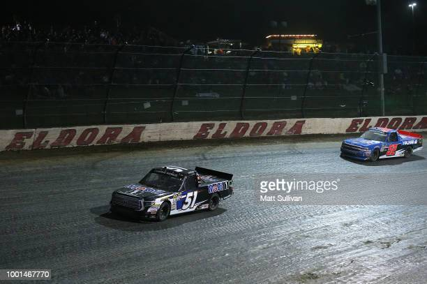 Logan Seavey driver of the Mobil 1 Toyota leads Stewart Friesen driver of the We Build America Chevrolet during the NASCAR Camping World Truck Series...