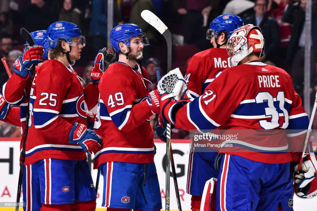 Logan Shaw #49 of the Montreal Canadiens congratulates goaltender Carey Price #31 for their victory against the Detroit Red Wings during the NHL game at the Bell Centre on March 26, 2018 in Montreal, Quebec, Canada. The Montreal Canadiens defeated the Detroit Red Wings 4-2.