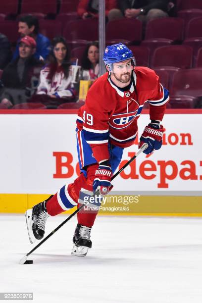 Logan Shaw of the Montreal Canadiens skates the puck during the warmup against the New York Rangers prior to the NHL game at the Bell Centre on...