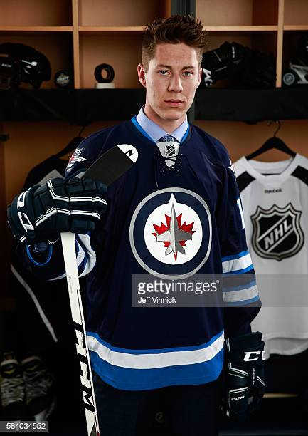 Logan Stanley selected 18th overall by the Winnipeg Jets poses for a portrait during round one of the 2016 NHL Draft at First Niagara Center on June...