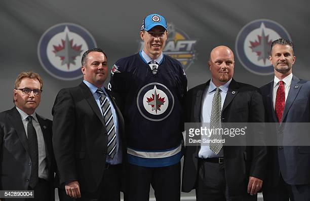 Logan Stanley selected 18th overall by the Winnipeg Jets poses onstage during round one of the 2016 NHL Draft at First Niagara Center on June 24 2016...