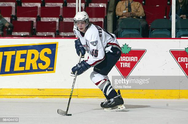 Logan Stephenson of the Tri-City Americans controls the puck against the Vancouver Giants during their WHL game on October 26, 2005 at the Pacific...