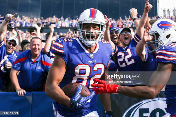 Logan Thomas of the Buffalo Bills celebrates with fans after scoring a touchdown during the third quarter of an NFL game against the Tampa Bay...