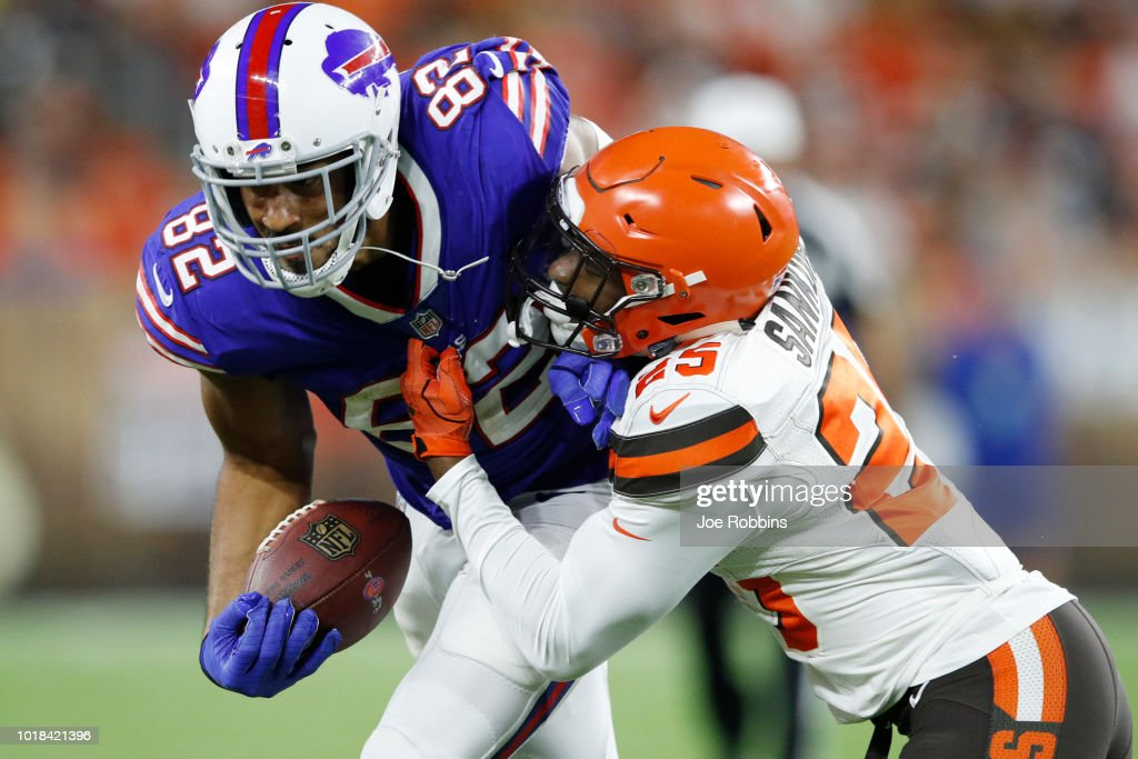 Logan Thomas #82 of the Buffalo Bills fights for yardage after catching a pass against Tigie Sankoh #25 of the Cleveland Browns in the second quarter of a preseason game at FirstEnergy Stadium on August 17, 2018 in Cleveland, Ohio.