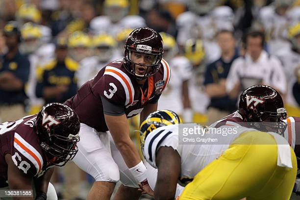 Logan Thomas of the Virginia Tech Hokies calls signals out at the line of scrimmage in the first quarter against the Michigan Wolverines during the...