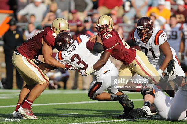 Logan Thomas of the Virginia Tech Hokies gets tackled during play against the Boston College Eagles in the second half at Alumni Stadium The Eagles...