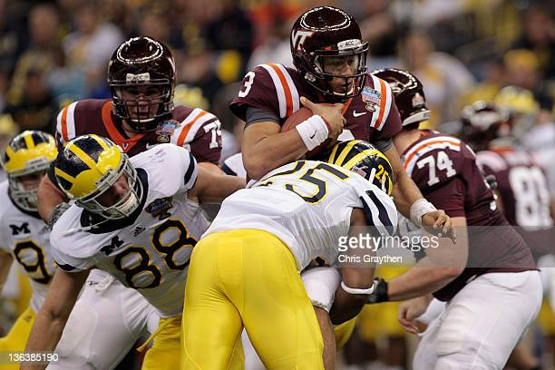 Logan Thomas of the Virginia Tech Hokies is sacked by the Michigan Wolverines defense during the Allstate Sugar Bowl at MercedesBenz Superdome on...