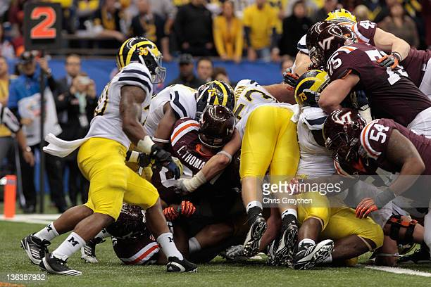 Logan Thomas of the Virginia Tech Hokies scores a 1yard rushing touchdown in the fourth quarter against the Michigan Wolverines during the Allstate...