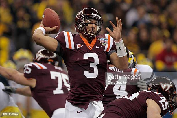 Logan Thomas of the Virginia Tech Hokies throws a pass against the Michigan Wolverines during the Allstate Sugar Bowl at MercedesBenz Superdome on...