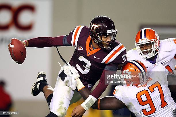 Logan Thomas of the Virginia Tech University Hokies is sacked by Malliciah Goodman of the Clemson University Tigers on October 1 2011 at Lane Stadium...