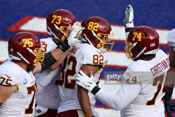 Logan Thomas of the Washington Football Team celebrates after a five-yard catch for a touchdown against the New York Giants in the second quarter of...