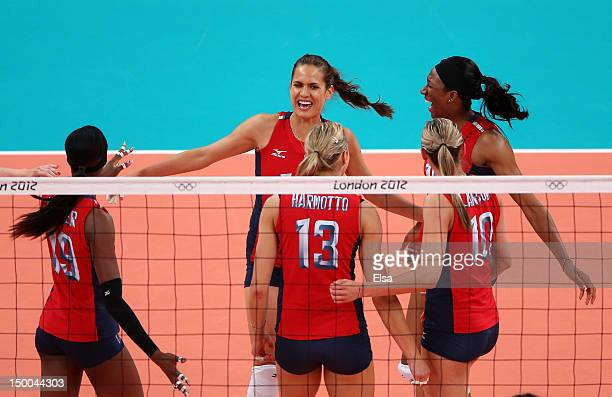 Logan Tom Destinee Hooker Christa Harmotto Jordan Larson and Foluke Akinradewo of United States celebrate after a point against Korea during the...