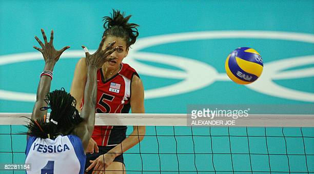 Logan Tom of the US slams a shot onto Yessica Paz Hidalgo of Venezuela during a Women's Preliminary Olympic Volleyball Pool A match 14 game at the...