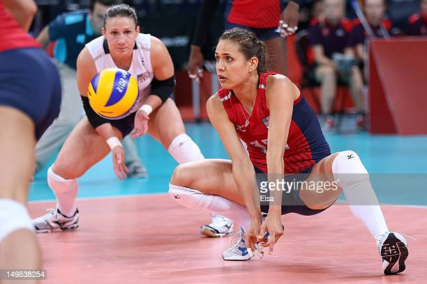 Logan Tom of United States returns serve in the Women's Volleyball Preliminary match between the United States and Brazil on Day 3 of the London 2012...