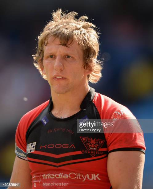 Logan Tomkins of Salford Red Devils in action during the Super League match between Widnes Vikings and Salford Red Devils at Etihad Stadium on May 17...