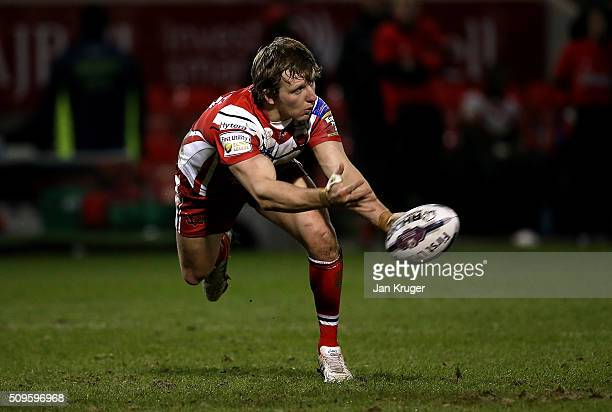 Logan Tomkins of Salford Red Devils spins the ball out during the First Utility Super League match between Salford City Reds and St Helens at AJ Bell...