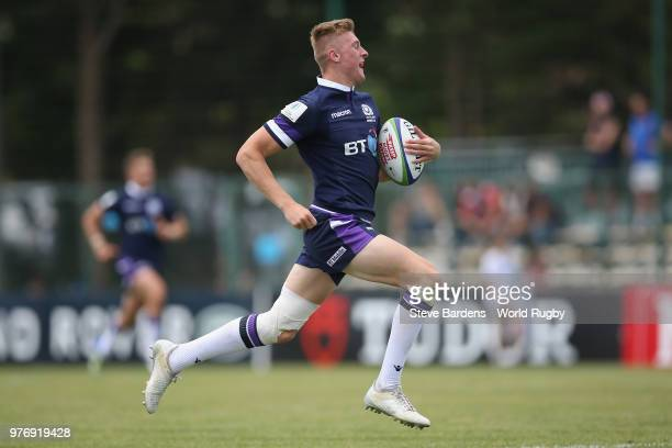 Logan Trotter of Scotland breaks away to score a try during the World Rugby via Getty Images Under 20 Championship 9th Place playoff match between...