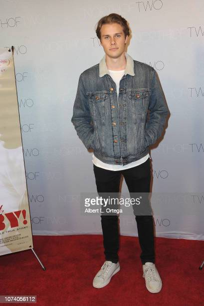 Logan Troyer arrives for the premiere of 'Heart Baby' held at The Ahrya Fine Arts Laemmle Theater on November 23 2018 in Beverly Hills California